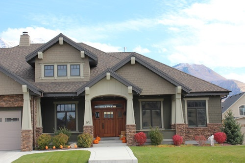Stone wavy siding and roof peaks home decor for Exterior house peak decorations