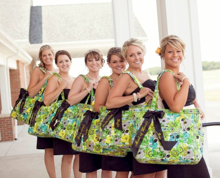 A beautiful bridal party and Get Carried Away totes filled with their wedding essentials.