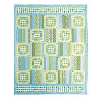 """Ocean Breeze by Jean Nolte. This easily-constructed quilt features light and breezy fabrics from Michael Miller. It's reminiscent of a day at the beach.   Quilt Size: 74"""" x 90"""" Project Rating: Easy    Instructions are in the 2009 issue of Kids Quilts and with the kit! Makes a great dorm quilt."""