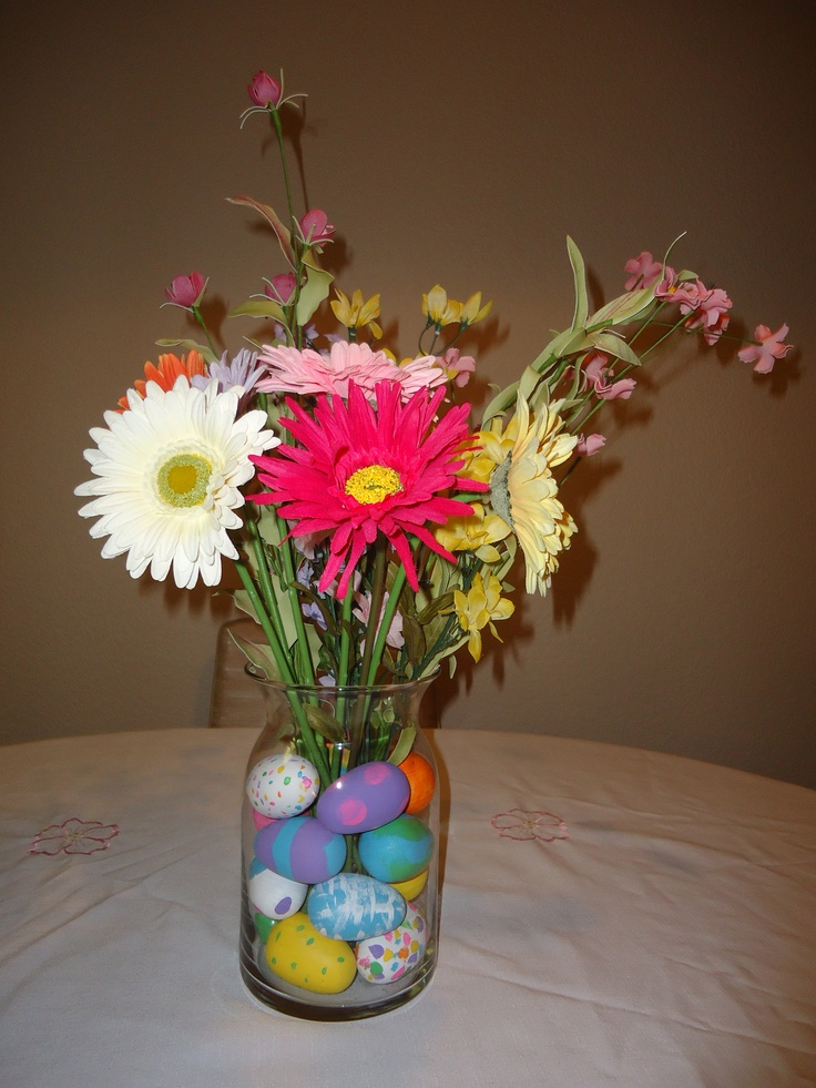 Easter/spring centerpiece. I used wooden eggs and fake flowers so I can reuse it next year but boiled eggs and real flowers would work as well