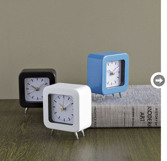 Get the Mad Men look with mid-century modern decor ... like these quaint, footed alarm clocks!