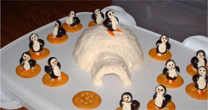 Cream cheese penguins with cream cheese igloo