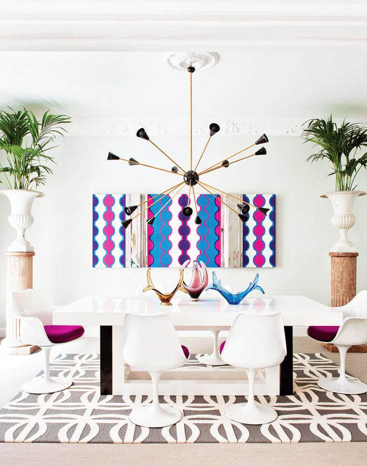 Inside a Groovy Pad Fit for a Queen// tulip chairs, indoor palms, urns, graphic art