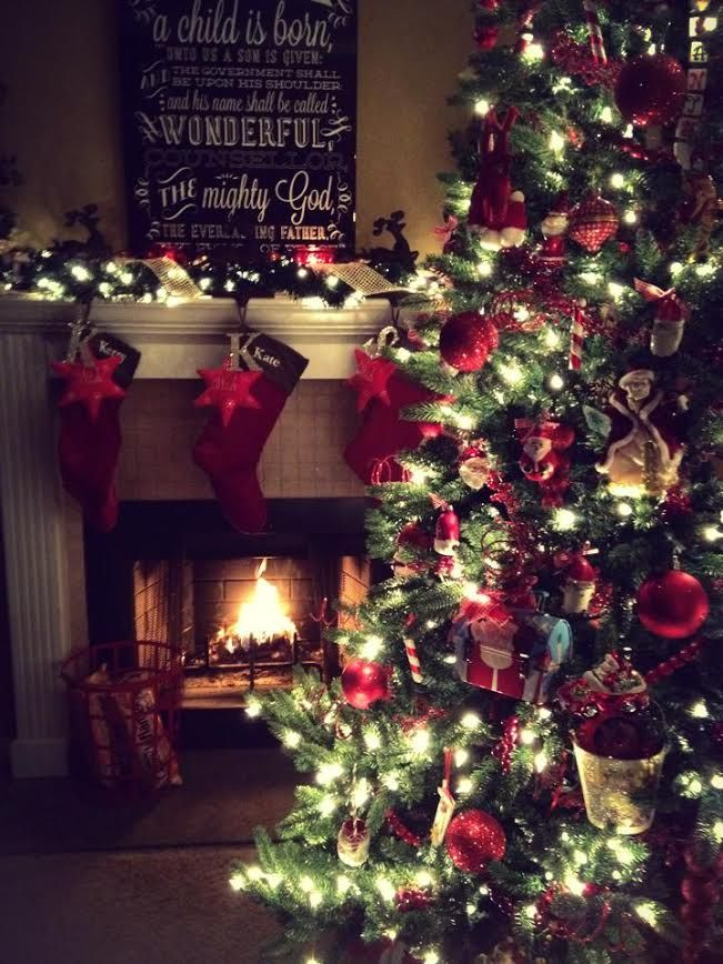 Christmas decorations, with tree and stockings around fireplace