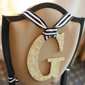 if we use ribbon for the chair signs, you and bill could still use your cork letters. we can just hang them with the same ribbon.