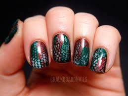 base and then draw on layers of scales with an art pen. Fall nail art