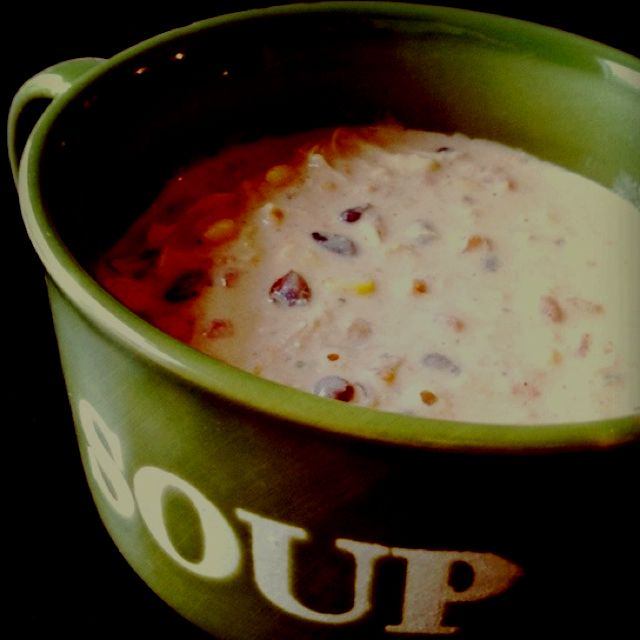 totally yummy soup: A can of rotel, can of corn, can of black beans (drained & rinsed), 2 frozen chicken breasts, 8 oz cream cheese, 1 packet dry ranch dressing, 1 tablespoon cumin, 1 teaspoon onion powder, 1 teaspoon chili powder. Put all ingredients in crock pot and cook 6-8 hours. Shred chicken, and enjoy!