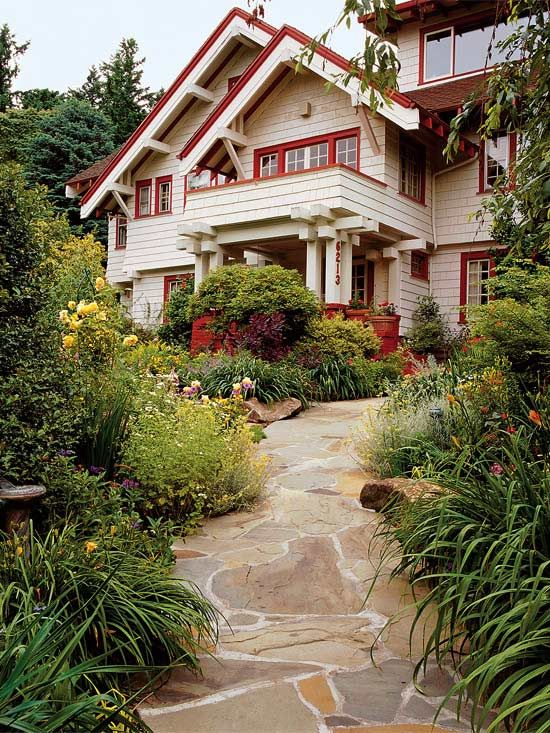 Match Your Architecture  A patchwork stone path perfectly complements the precise lines of this Craftsman-style house. Including subtle curves in the path ensures that visitors encounter a few little surprises as they wend their way to the door.