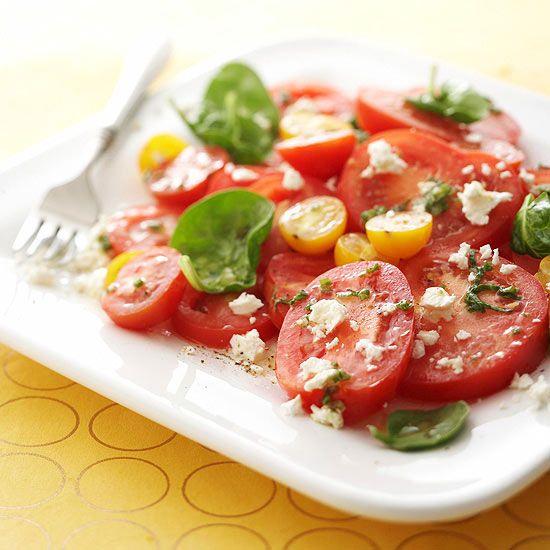 Feta cheese and an herb vinaigrette flavor this Five-Tomato Salad. Recipe: www.bhg.com/recipe/salads/five-tomato-salad/?socsrc=bhgpin080112fivetomatosalad