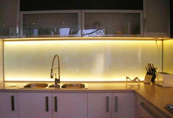interesting lighting with a tempered glass backsplash
