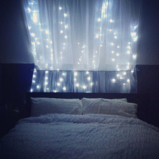 String lights canopy over bed. 2 sets of string lights, 2 sheer curtains and 2 Curtain rods ...