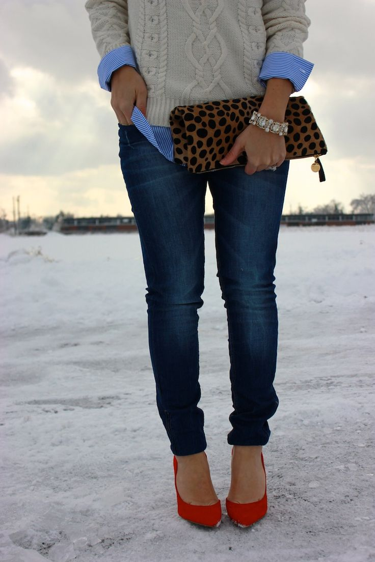 Leopard clutch and red pumps.
