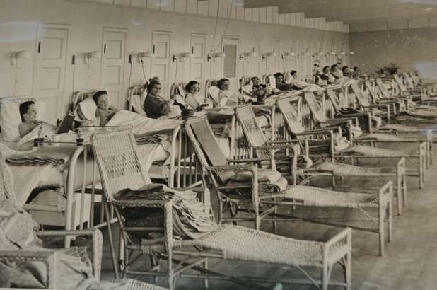 This undated photograph shows patients at the Eastern Oregon Tuberculosis Hospital.  I love that there is a wicker lounge chair at the foot of each bed!
