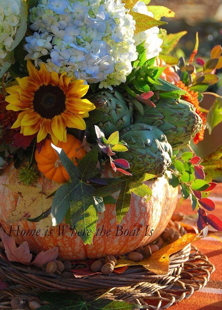 A pumpkin vase centerpiece for thanksgiving