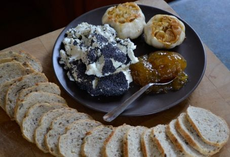 Poppy seed-crusted Goat Cheese with Crostini, Roasted Garlic, Fig Jam ...