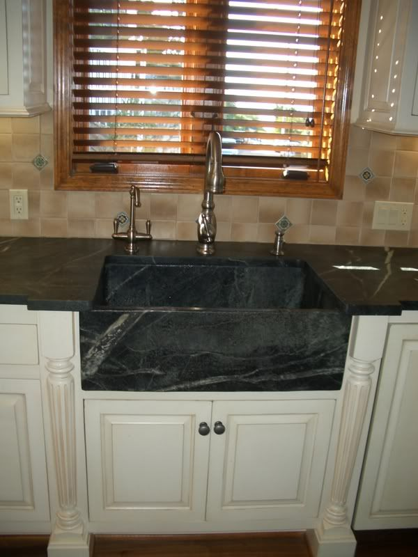 sink  like the farmhouse style with the decorative elements on either