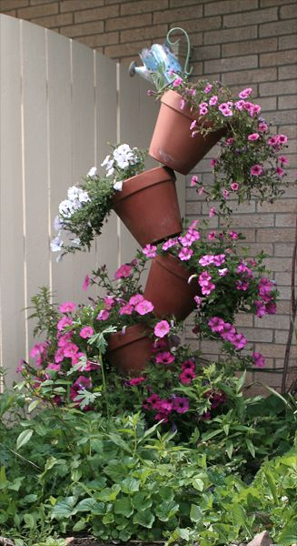 Tipsy pots wave petunias gardening pinterest - Wave petunias in containers ...