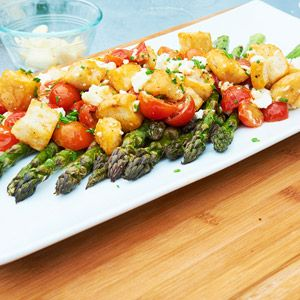 Bright cherry tomatoes and nutrient-rich asparagus are beautifully ...