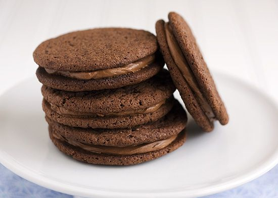 Chocolate malt sandwich cookies. http://www.handletheheat.com/2011/06 ...