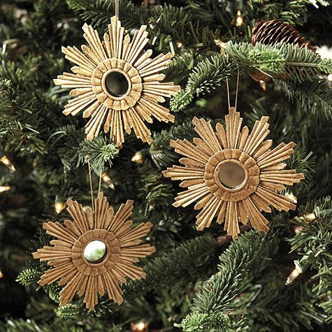 Each one is a little work of art. The staggered rays of our Venetian Star Ornament are crafted by hand of tin and layered for rich 3-dimensional textur
