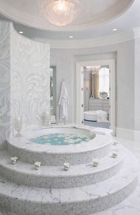 Beautiful marble bathroom and round tub