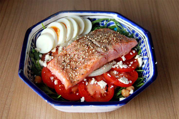 Salad with arugula, tomato, chickpeas, feta cheese, onion; pan-fried ...