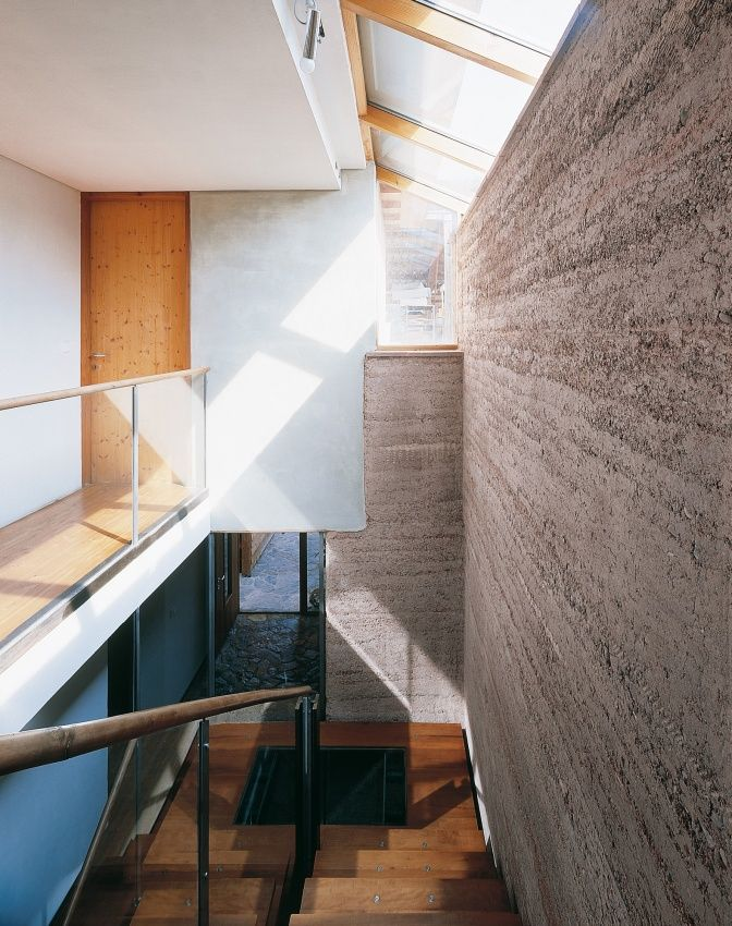 Rammed earth home; foundation/basement walls are concrete; outer walls are 63cm high Pise walls, on-site material mixed with crushed brick; no surfaces were plastered.Martin Rauch; www.lehmtonerde.at