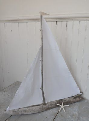 white linen driftwood sailboat