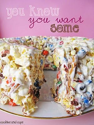 "Popcorn Cake. ""A 'cake' made of buttery, salty popcorn, dotted with colorful M&M;'s and salty pretzel sticks, all held together by sticky, sweet marshmallow."""