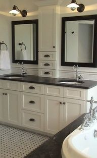 bathroom wall with cabinets between mirrors - Google Search
