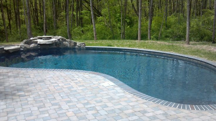 Kidney shaped pool with waterfall swimming pools pinterest for Images of kidney shaped pools