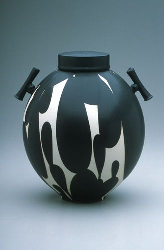 Sam Scott. Black and white lidded jar with handles, Porcelain, 12 in. tall. copyright Sam Scott. 2005