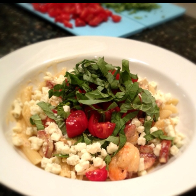 ... Sauce. Garnished with fresh basil, cherry tomatoes and crumbled blue