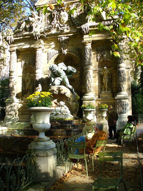 Enjoying a beautiful autumn day at Fontaine de Medicis in Paris, France