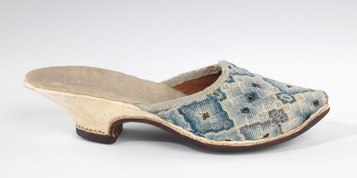 "This particular pair of mules are from the early 18th century but demonstrate the timelessness of the form, and in this case, even the pattern & palette. The style of embroidery is known as ""Florentine"" work, a type of flame stitch canvas work. Probably European, the mules are silk, linen, leather with dimensions: 2 x 9 in. (5.1 x 22.9 cm) @Karen Bitterman Museum of Art Acc.# 2009.300.1483a, b"
