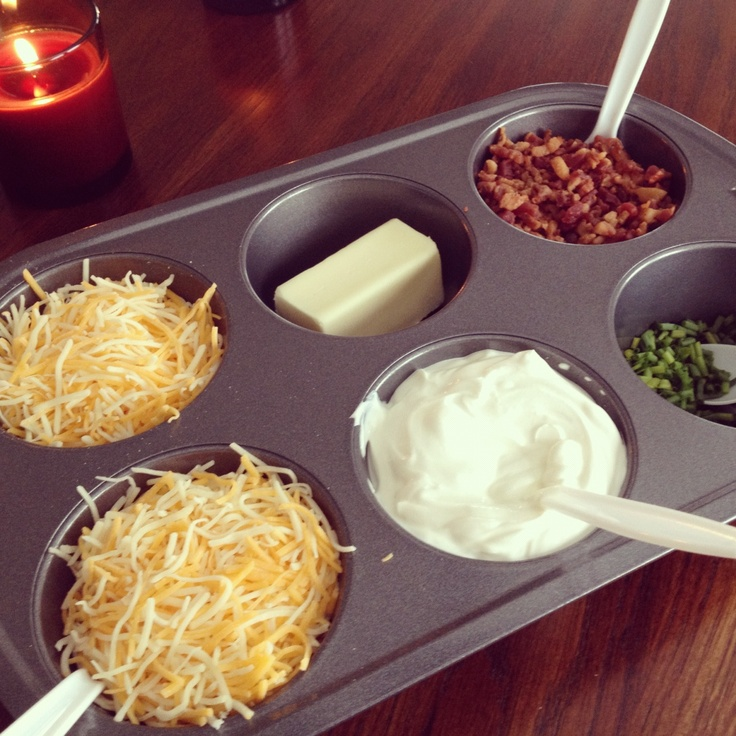 ... Potato Bar - Shredded cheese, sour cream, butter, bacon bits, chives