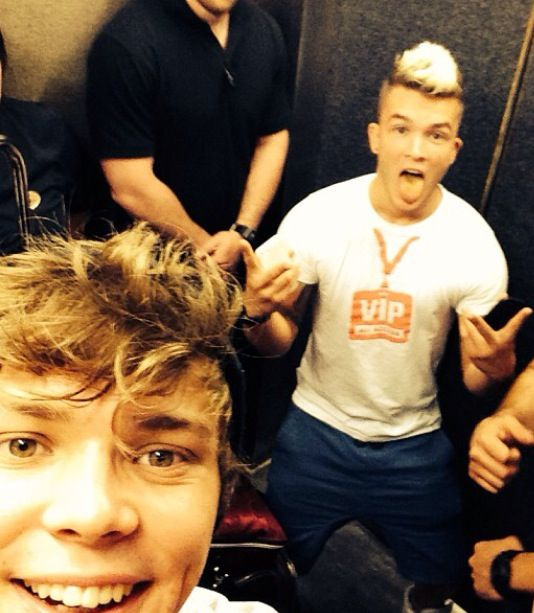 Ashton with Josh in the background. #DrummerBoys