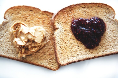 Adorable toast with jam and peanut butter hearts