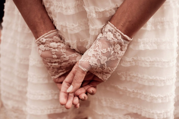 pretty lace gloves accessorize a ruffly white bridesmaid dress  Photography by http://angelsmithphotography.com.au