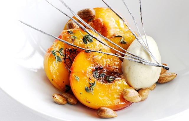 Roast peaches with lemon thyme, vanilla ice cream and toasted almonds