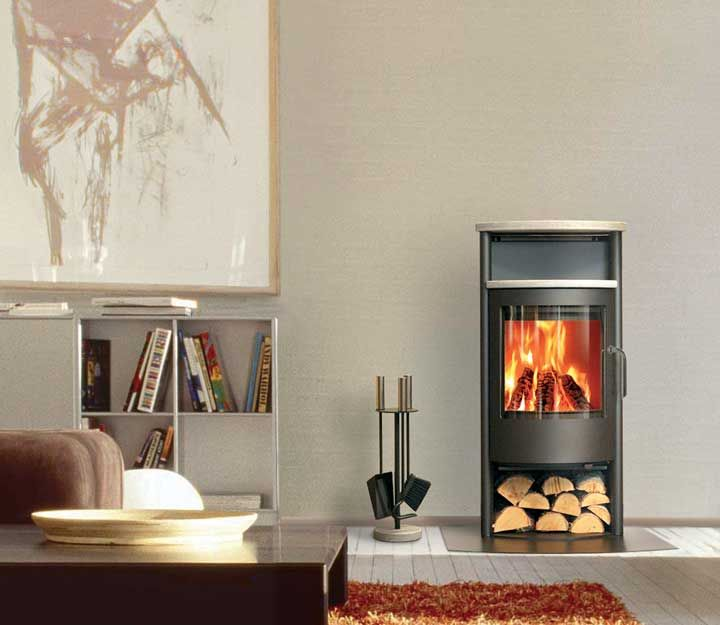 Love how beautifully this Rais wood fireplace fits into this home. So simple, so sleek.