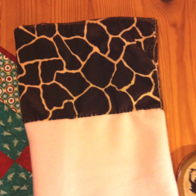 I'm not finished yet. But it's the top of my stocking. I hand sewed it. I will post a new pic when I get the final touches.