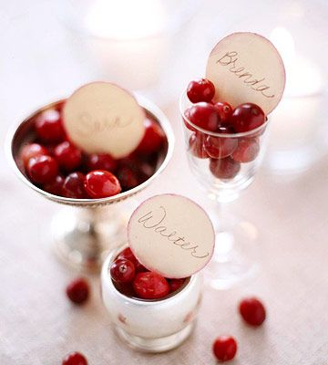 Fill candle holders with cranberries for elegant place settings. More ways to decorate with cranberries this year: http://www.bhg.com/christmas/indoor-decorating/decorating-with-cranberries/?socsrc=bhgpin103012cranberrytablesettings#page=3