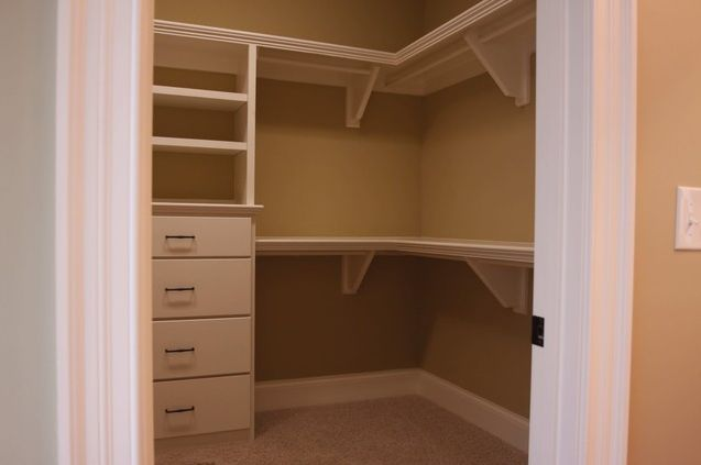 Walk In Closet With Wrap Around Shelves And Hanger Rods