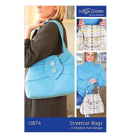 Perhaps a new big purse?  I love the blue two button version.