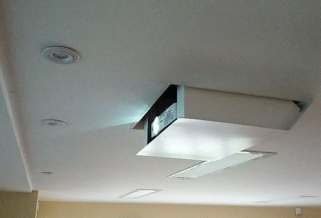 Hidden ceiling projector living spaces pinterest for Hiding a projector in living room