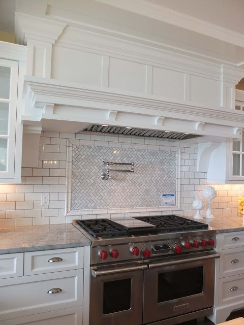 simple subway tile backsplash with herringbone carrera marble behind