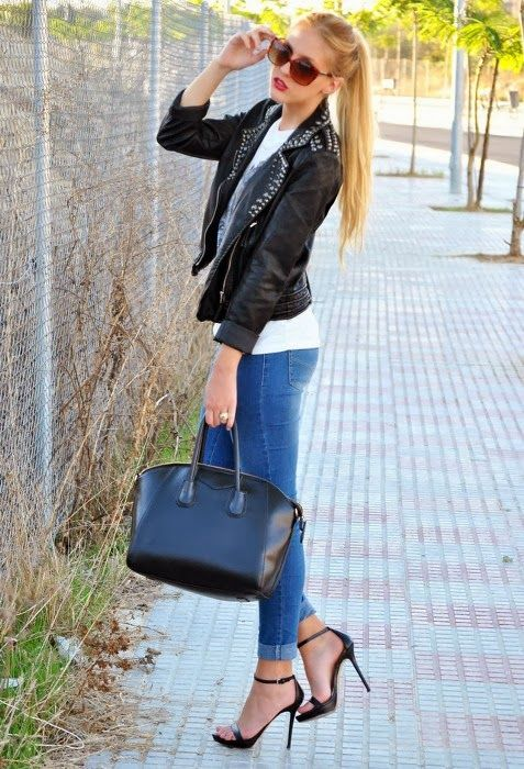 Very Confident View. Black Leather Jackets, Blue Jeans and High Heel Shoes with Suitable Accessories