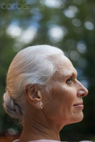 Graceful woman with gray hair in bun   Gorgeous Gray etc.