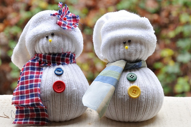 Use an old sock and stuff it with rice to make these adorable snowmen!! =) you can use buttons and fabric for a cute touch =)